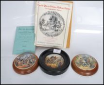 A group of three Staffordshire Prattware pot lids to include 'The Village Wedding', 'The Wolf and