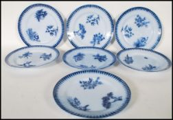 A matching set of seven early 20th Century blue and white dinner plates having blue pattern