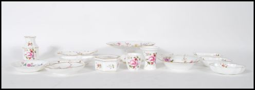 A collection of fourteen pieces of bone china by Royal Crown Derby, all decorated with fauna and