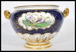 A late 19th Century Royal Worcester soup tureen of large form, having twin carrying handles finished