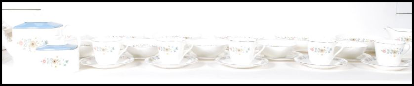 A Royal Doulton part tea service in the Pastorale pattern. Model H5002. The set comprising, cups,
