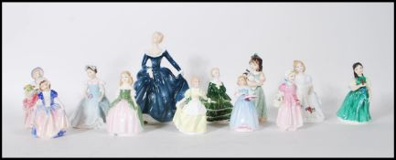A collection of eleven Royal Doulton ceramic figurines to include Cissie HN 1809 First Recital HN
