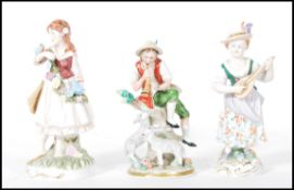 A group of three German continental porcelain figures dating from the early 20th Century to