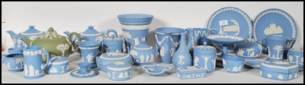A large collection of 20th Century Wedgwood Jasperware ceramics to included lidded trinket pots,