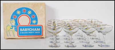 A selection of 20th Century vintage retro Babycham glasses having printed yellow fawn logo's to