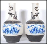 A pair of late 19th Century tall crackle glaze vases of baluster form, each with a panel to the