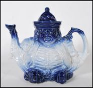 An early 20th Century Staffordshire ceramic teapot in the form of a Toby character. The teapot
