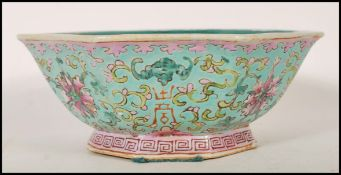 A Chinese Cantonese ( Canton ) footed centerpiece bowl of octagonal form having a blue ground