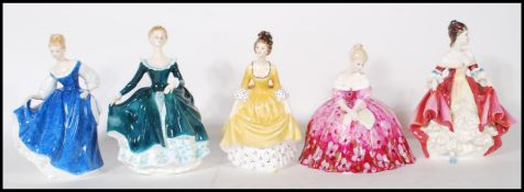A collection of Royal Doulton ceramic figurines to include Southern Belle HN 1957, Kay HN 3340,