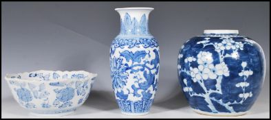 A 19th Century Chinese ginger jar of large proportions and bulbous form being hand painted in blue