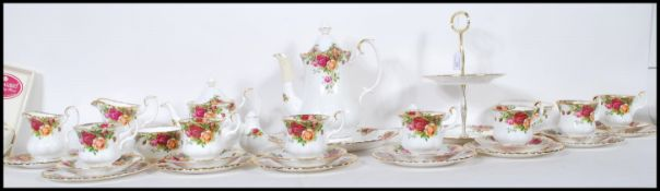 A Royal Albert fine bone china coffee and part tea service in the Old Country Roses pattern. The