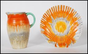 A 1930's Art Deco Shelley ceramic side plate in the form of a scallop shell having an orange and