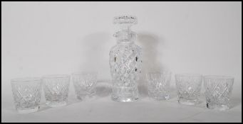 A 20th Century cut glass decanter of tapering cylindrical form having a pourer to the neck with a