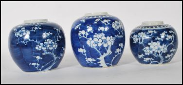 A group of three Chinese blue and white ginger jars to include two larger jars and one smaller,