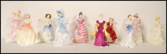 A collection of Royal Doulton ceramic figurines to include Flowers of Love - Forget Me Nots HN 3700