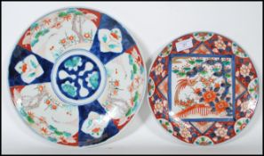 A 19th Century Chinese charger decorated with a central circular panel surrounded by six panels