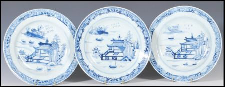 A group of three Chinese 18th Century ceramic blue and white plates all hand painted with a pagoda