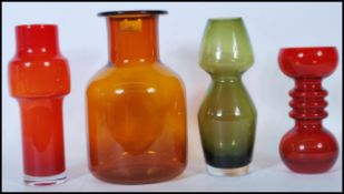A collection of four vintage retro studio art glass vases to include an example by Dartington,