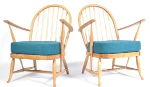 A PAIR OF ERCOL 1950'S LOW WINDSOR CHAIRS BY LUCIAN EROLANI
