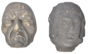 A PAIR OF EARLY CARVED STONE MEDIEVAL CARVED HEADS - CAUBLES