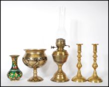 A collection of antique brass items to include a 1