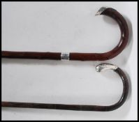Two 20th Century walking stick canes to include a