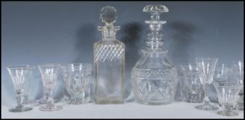 A collection of glasses and decanters dating from