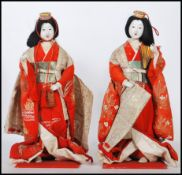 A pair of 20th Century Chinese ornamental dolls de