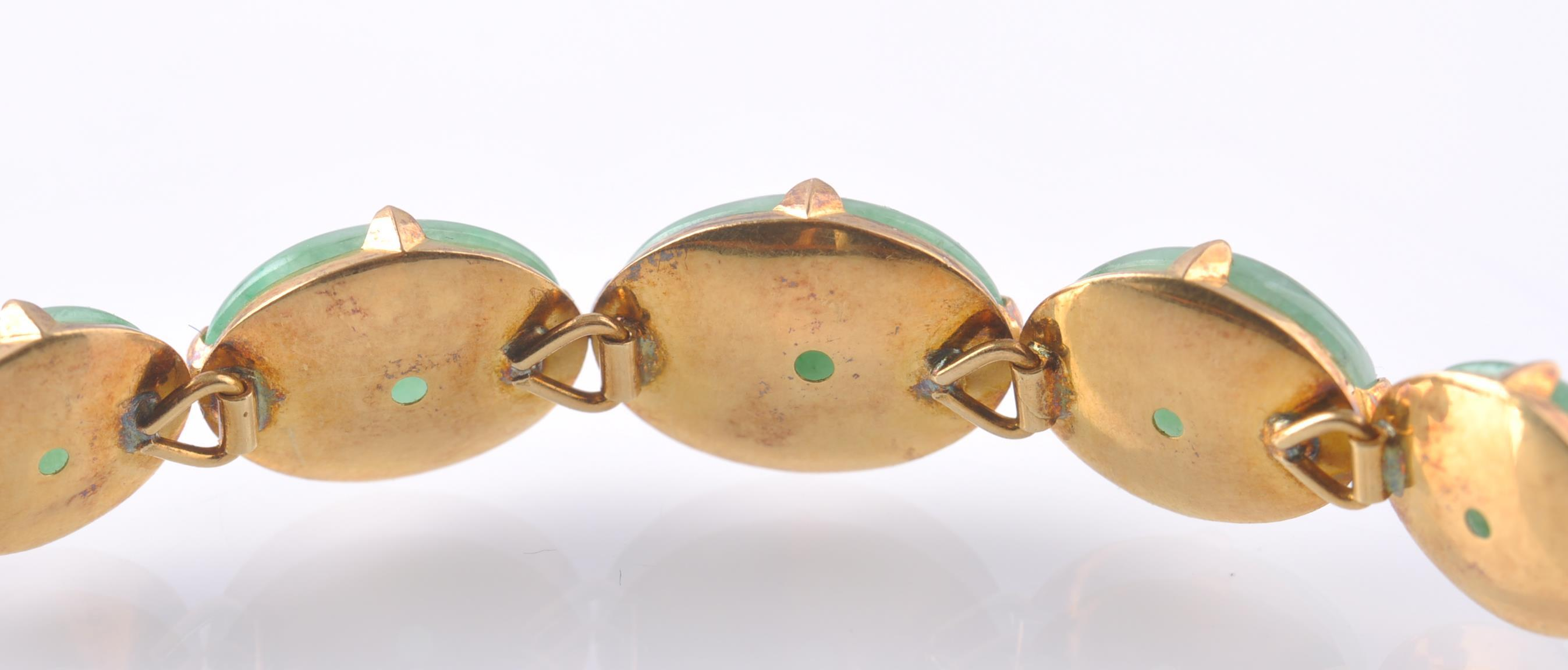 Lot 47 - A GOLD & NATURAL JADE BRACELET WITH 5 JADE CABOCHO