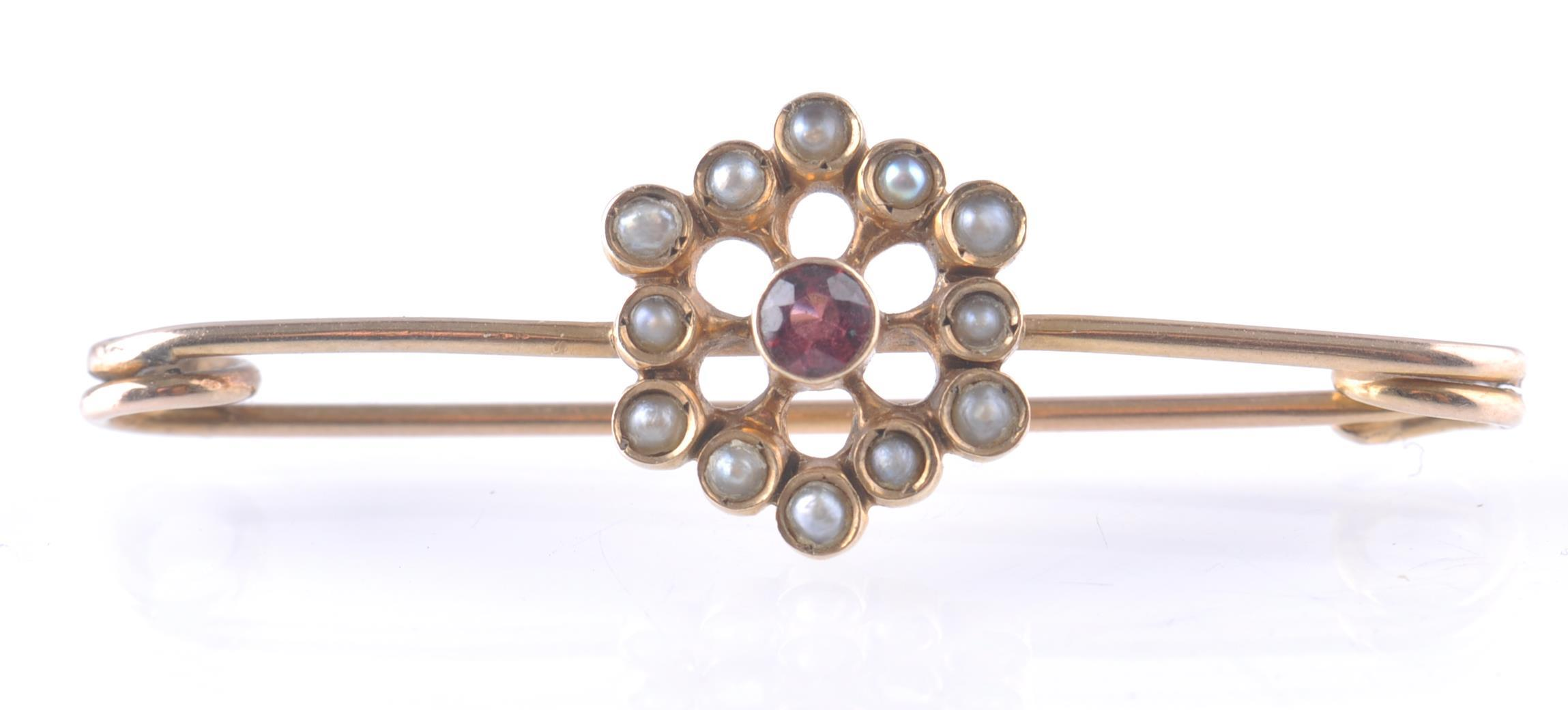 Lot 131 - VICTORIAN 9CT GOLD SEED PEARL AND RUBY BAR BROOCH