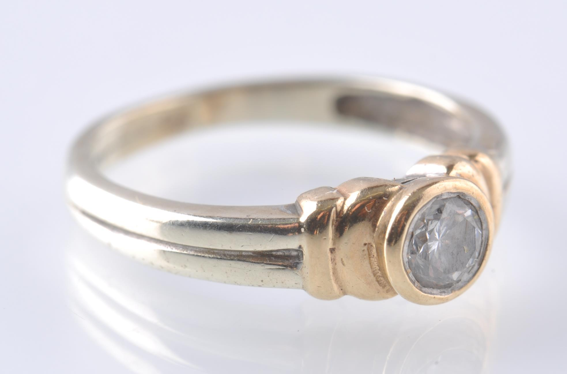 Lot 110 - A CONTEMPORARY 9CT WHITE AND YELLOW GOLD DIAMOND S