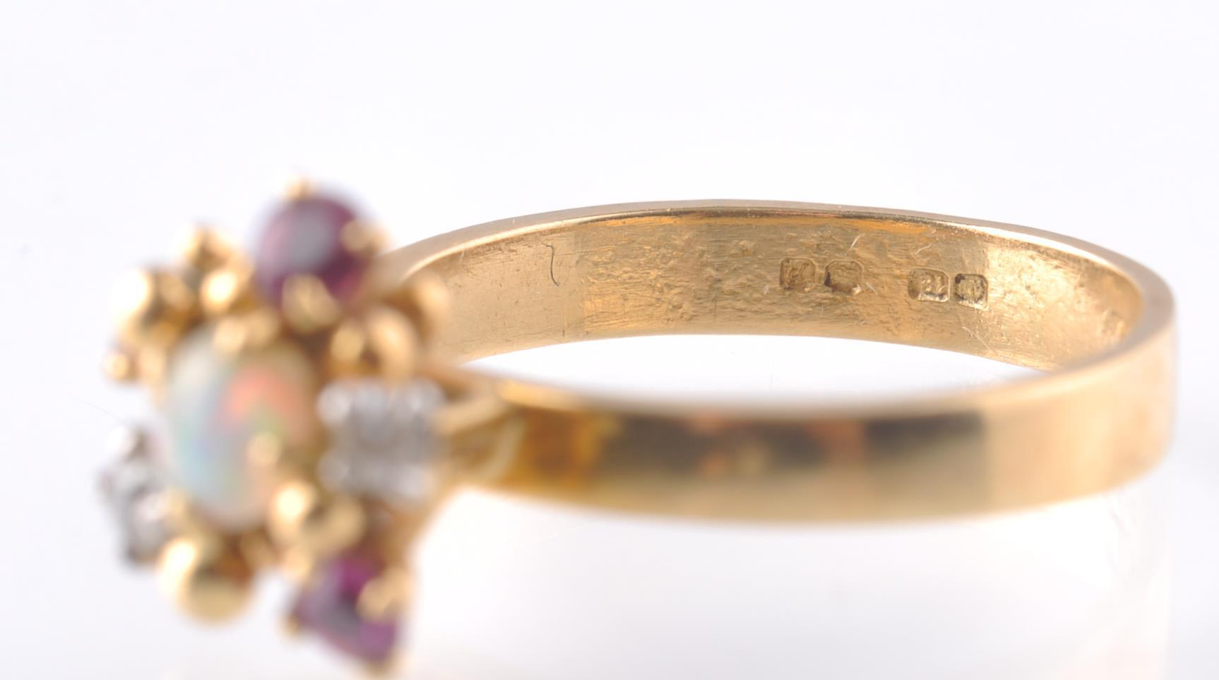 Lot 30 - A HALLMARKED OPAL RUBY AND DIAMOND CLUSTER RING