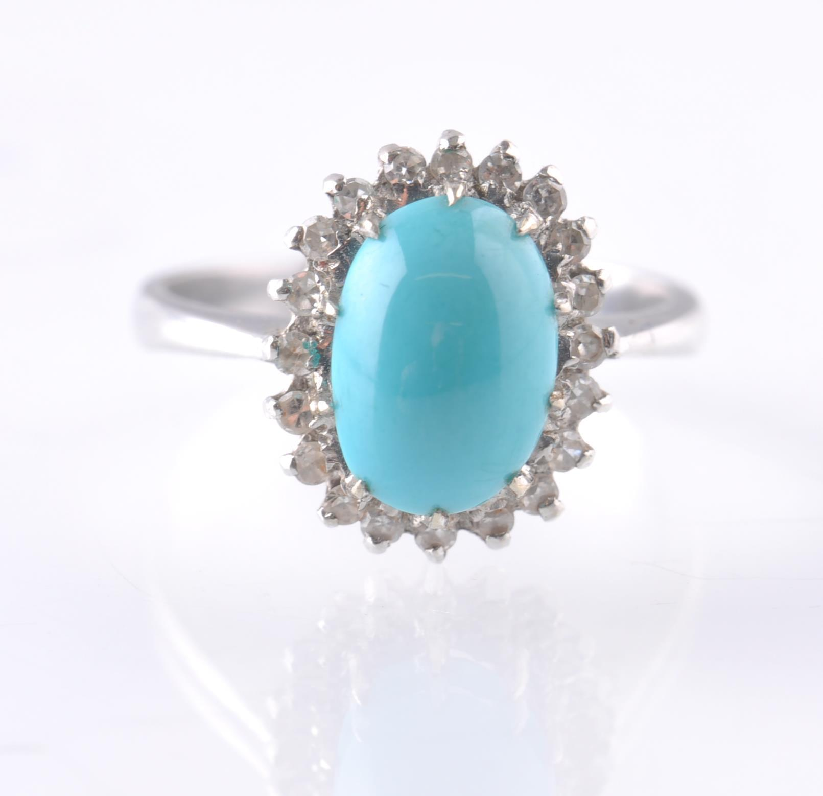 Lot 43 - AN 18CT WHITE GOLD TURQUOISE AND DIAMOND OVAL CLUS