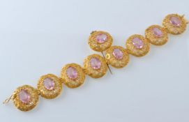 A GOLD FILIGREE AND PINK STONE BRACELET WITH PIN