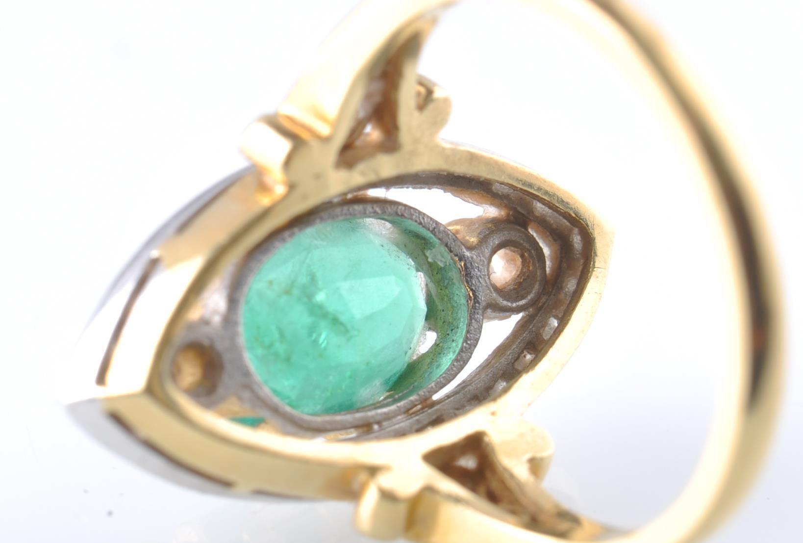 Lot 125 - A HALLMARKED 18CT GOD EMERALD AND DIAMOND RING