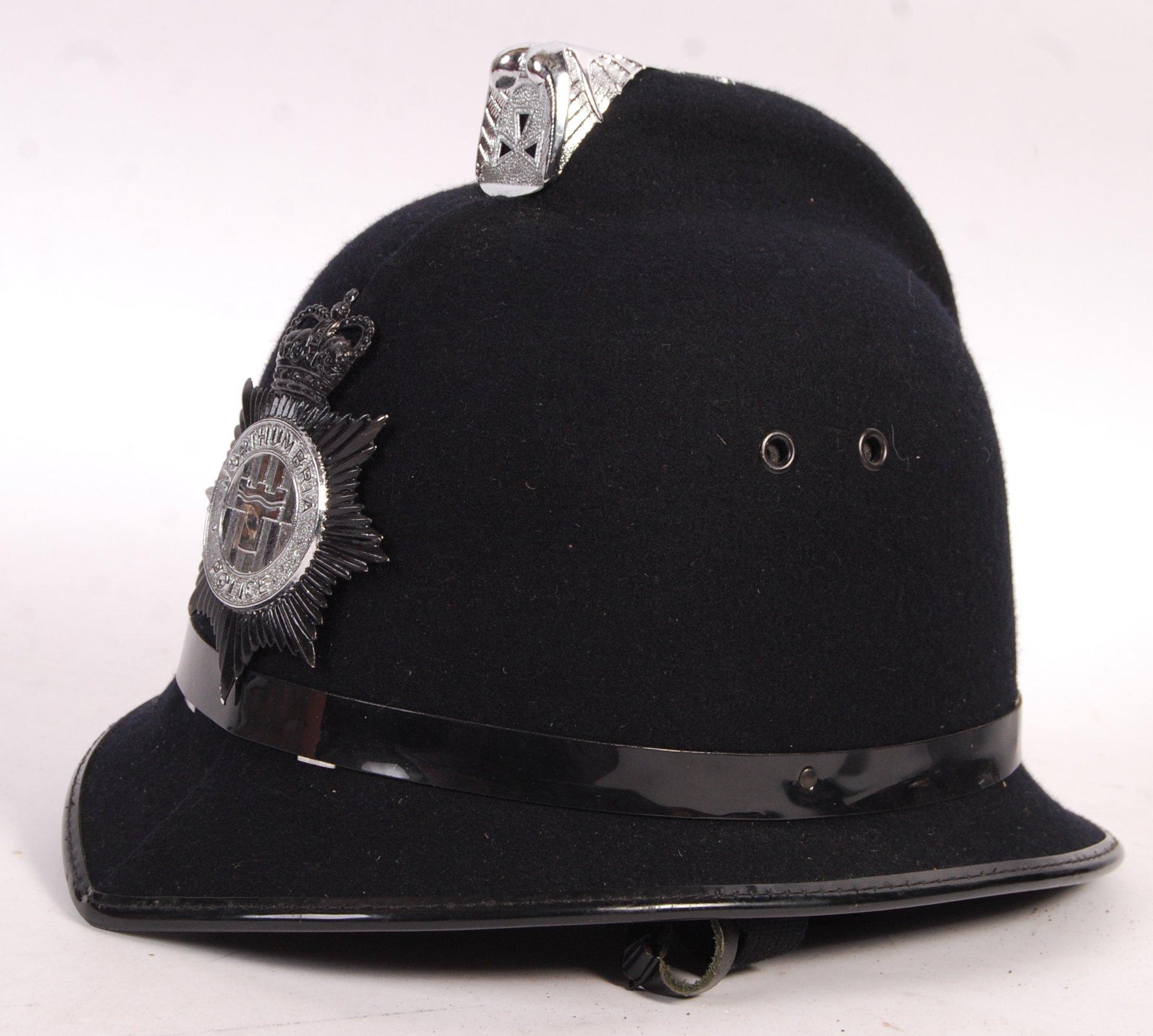 Lot 197 - 20TH CENTURY NORTHUMBRIA POLICE UNIFORM HELMET