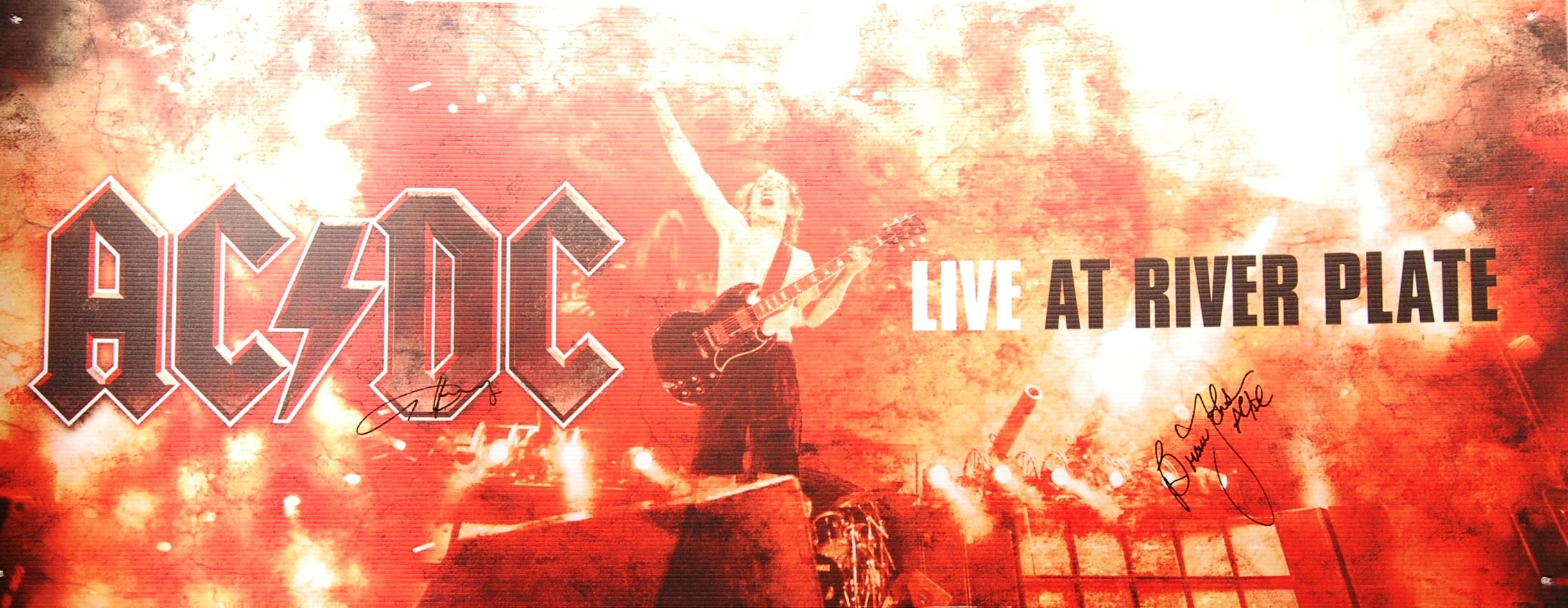 Lot 88 - RARE AC/DC DUAL SIGNED LARGE DVD LAUNCH POSTER CAR