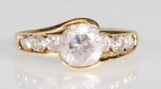 A hallmarked 14ct gold and CZ dress ring. The ring