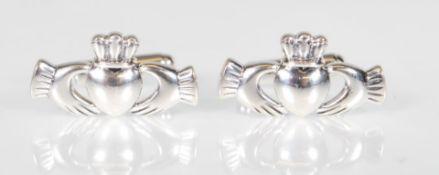 A pair of stamped 925 silver cufflinks having Iris