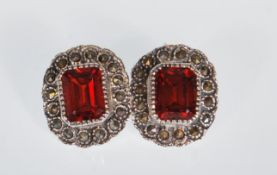 A pair of ladies silver stud earrings set with rec