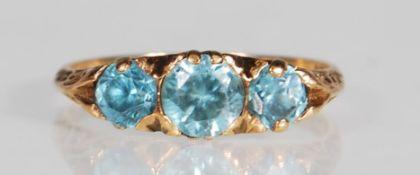 A hallmarked 9ct gold and blue zircon three stone