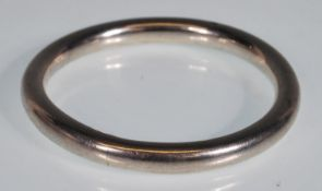 A stamped 925 silver bangle of typical form. Measu