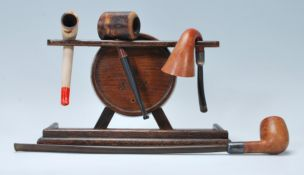 A selection of early 20th Century smoking pipes to