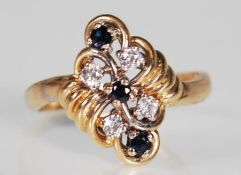 A hallmarked 9ct gold sapphire and white stone dre