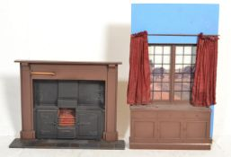 A pair of 20th Century shop display / salesmen / a