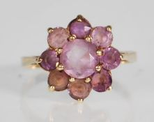 A 9ct yellow gold ring having a flower head mount