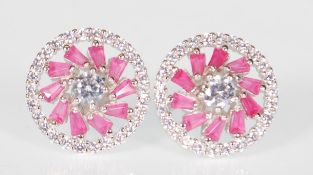 A pair of ladies silver stud earrings of round for