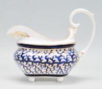 A 19th Century Crown Derby porcelain sauce boat /