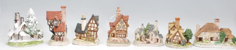 A group of seven David WinterCottage ornaments to