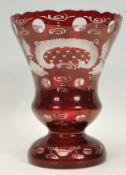 A 20th Century ruby glass vase of tapering knopped
